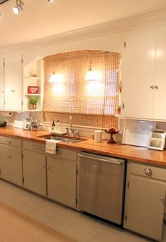 Cream top cabinets and greenish grey bottom...also love the bamboo shade