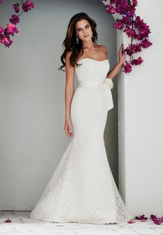 A beautiful and modern Mikaella lace fishtail wedding dress featuring re-embroidered lace, a ribbon sash with flower embellishment and a sweeping train. Perfect for romantic summer wedding.Stocked by www.paperswanbride.co.nz in Wellington, New Zealand