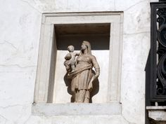In Venice, up on a wall, in a niche, the Madonna and Child. Madonna And Child, Mother And Child, Venice, Statue, Children, Wall, Mother Son, Young Children, Boys