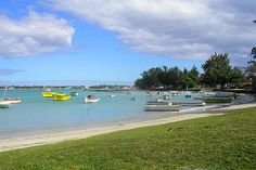 This is the town of Grand Baie/Bay, just north of Trou aux Biches. Grand Bay is lively in the evenings and encompasses several reasonable hotels, B, restaurants and bars. This town could be a good place to find budget accommodation near northwest beaches such as Pereybere.