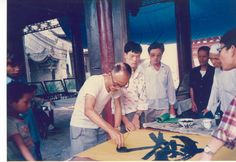 Practising calligraphy in the street in Xian in August 1986. Learn more about THE WOMAN WHO LOST CHINA by Rhiannon Jenkins Tsang at http://www.open-bks.com/library/moderns/the-woman-who-lost-china/about-book.html