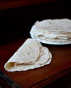 Gluten Free Flour Tortillas Makes about 5 big tortialls  1/2 cup white rice flour 1/2 cup brown rice flour 1 cup tapioca flour 1 tablespoon white sugar 1/2 teaspoon baking powder 1/2 teaspoon salt  2 teaspoons xanthan gum 2 tablespoons shortening  3/4 cup water