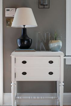 great entry table made of old sewing table found on craiglist and painted white