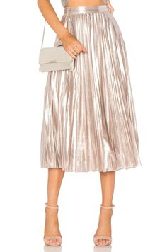 Metallic midi skirt paired with a grey tshirt knotted - never thought of that.
