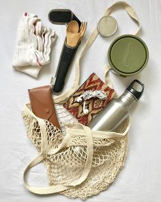 """#MyLifeWithoutPlastic sustainyoself: """"Zero-waste, on-the-go essentials! What you see here is what I always carry in my bag: •steel water bottle •wallet/headphones •sunglasses •homemade lip balm •some kind of container •rag/napkin •bamboo cutlery + straw •AND always a reusable bag/tote Since being zero-waste I've noticed that you have to be organized and well prepared in case the world wants to throw trash at you. But it's all worth it when you're making the world a cleaner, safer place…"""