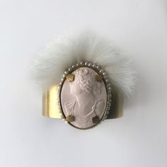 The Camilla Cuff features a gorgeous Victorian style cameo in blush pink. This is encircled by a string of genuine freshwater pearls, crowned with. Camilla, Victorian Fashion, Blush Pink, Cuffs, Gemstone Rings, Gemstones, Pearls, Jewelry, Style