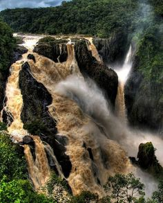 Barron Falls is where the Barron River makes its descent from the Atherton Tablelands to the Cairns coastal plain, in Queensland, Australia