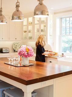 I like the style in this kitchen for my sewing studio work space - white cabinets, warm wood table top and chrome pendant lighting. Delicious Designs Home: Interior Design in Hingham, Cohasset, Norwell and Scituate