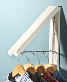 This hanger folds against the wall when not in use. The Arrow Hanger. Single and dual versions - Amazon, $15 for single. Laundry area, closet, by the ironing board, etc...