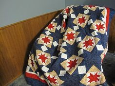 Red white blue and tan quilt.