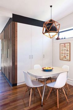 Adore the Eames chairs and pendant light