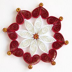 https://flic.kr/p/Bq5Nve | 6 point red and white quilled snowflake with gold glitter