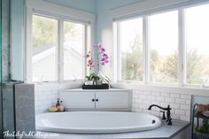 Love the hideaway for shampoo etc. Maybe sliding doors would be even more convenient. Master Bathroom Reveal - Parent's Edition - The Lilypad Cottage