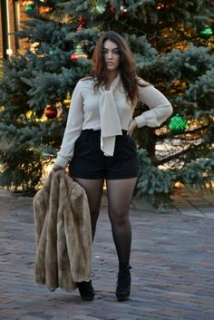 high waisted shorts and work blouse. with black tights and booties.