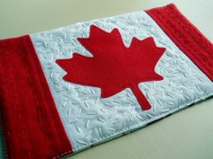 Canuck mug rug - oh, my family will love this.