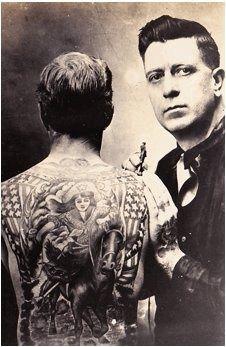 Ben Cordy shown tattooing an unidentified war vet of WW1.