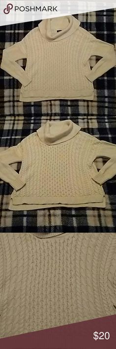 """AE SWEATER AEO off white knit sweater with the cowl neck. The body has like a braided style to it and then the sleeves are a knitted mesh style and there is a small slit on either side of the waste. So pretty and elegant, it has a flowy style to it a long with a slight hi-low. Made to be oversized and comfy, supposed to be a """"loose"""" fit. Also heavy and warm so perfect for the colder season but stylish and beautiful. It is gently used and there is some slight pilling from wash and wear in…"""