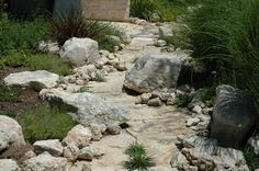 Building a natural stream to guide rain water around the house    After construction and planting, the streambed looks like a natural part of the landscape. Description from uk.pinterest.com. I searched for this on bing.com/images