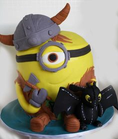 Here is my How To Train Your Dragon Minion cake i made for my sons year end party. It was a hit with the kids and my son. Minion is dressed like Hiccup and comes with an axe and stuffy toothless :)