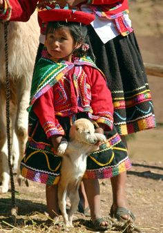 Young Girl With Puppy Dancing High Andes Peru