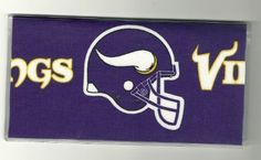 """NFL Football Minnesota Vikings Helmet Purple Checkbook Cover . $5.00. The sturdy clear VINYL COVER encases a fabric bonded design. Measuring 6 1/4"""" x 3 1/4"""",  the cover fits all standard bank checkbooks and banking registers.  All checkbook covers come with a register flap and a duplicate check flap  just like the bank, only flashier.  These checkbook covers are a great alternative to the expensive covers offered by banks and online check companies."""