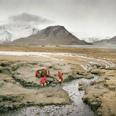 Matthieu Paley | Deep in the Pamir mountains, Wakhi women come to fetch water at a spring at the end of the Wakhan corridor in ‪Afghanistan‬. In the far right, a high pass leads into neighborhing Pakistan and the Hindukush mountain range.