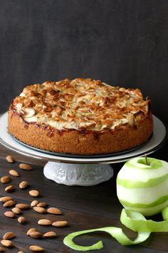 A vegan recipe for the classic German Apple Cake, featuring a layer of moist cake topped with tart apples and smothered with sweet, toasted almonds.