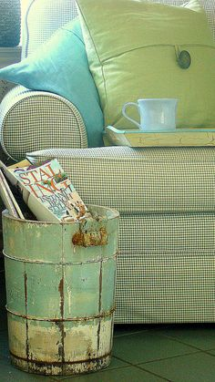 Old bucket as magazine holder. Beautiful patina.