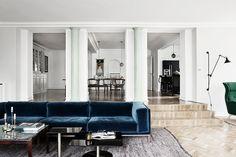 Love the modern blue velvet sofa. Modern and minimalistic sitting room.