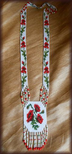 This is a traditional Ukrainian folk style necklace (Gerdan) are made of quality materials Czech beads and beads. 100% handmade. Gerdan long length of 43-45 cm. Ideal for turtlenecks and dresses You can also order a appropriate earring:  https://www.etsy.com/ru/listing/249761864/earrings-with-poppies-ukrainian-earrings?ref=shop_home_active_6   My wish is that it enhances your unique style and exquisite taste for something unusual and personal.  Thank you for...