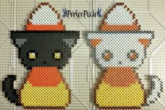More cute dressed up kitties! This time dressed as candy corn! I didn't come up with the designs for this, however I did make the perler as shown. Full credit goes to the original creator(s). If an...