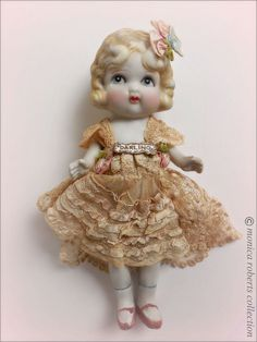 Bisque carnival doll