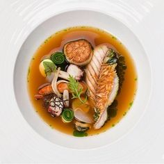 Bouillabaisse with assorted seafood in a sea squirt broth by chef Jungsik Kim of restaurant Jungsik from New York Fish Dishes, Seafood Dishes, Seafood Recipes, Gourmet Recipes, Food Design, Bistro Food, Food Porn, Weird Food, Exotic Food