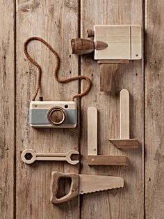Expertly crafted from solid wood, our collection of handmade wooden toys will delight children and parents alike. Choose between a vintage style film camera, camera or carpenty set.