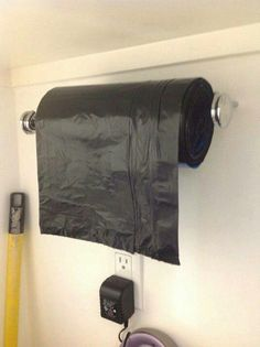 Paper towel holder for garbage bags. Good idea
