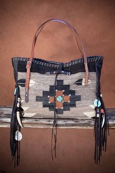 The BRISSA: Navajo Handbags made from blankets / rugs, vintage horse tack, and deer, elk or cowhide leathers. I embellish the bags with vintage trade beads, turquoise, coral, nickel silver/German silver Concho buttons, nickel silver spots/studs, and deer antler tips.