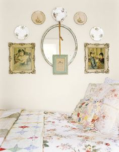 antique china plate displays on a wall -- love the addition of other shapes - pictures and mirror.