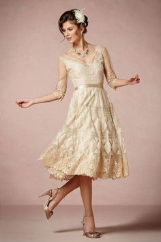Fabulous '50s Gowns Put Her In Her Lace The mix of lace, beads, and intricate details make this champagne-colored dress stand out.