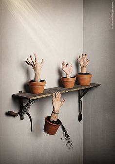 Potted Hands On Shelf - just photoshop, but could do this with one of the hand-making tutorials for creepy hands