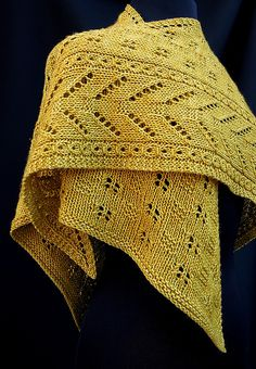 Thurmont is a contemporary, textured lace shawl featuring striking geometric design details. The asymmetrical shaping begins with just a few stitches which then flow into a handsome chevron lace panel flanked by faux cables. While that panel forms the left edge of the shawl, the remainder of the body is a growing field of cute garter squares alternating with eyelet motifs. The versatile shape may be draped in many configurations to be worn as either a shawl or a scarf.