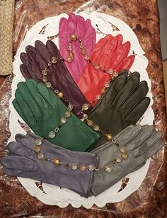 """VINTAGE LEATHER GLOVES $32 Whispering Hills Golf Estates  VINTAGE LEATHER GLOVES FOR SALE! Described top to bottom... 1. (SOLD) FUSHIA..SZ 6-1/2 to 7. Middle finger 3"""". VG condition, very gently worn, soft, supple leather, silky lining, wrist length, classic plain styling. $32.50 2. (SOLD) (L) WINE..SZ 7-1/2. Middle finger 3-1/4"""" Gorgeous, rich wine color, I. Magnin brand, superior kid leather, silk lined, wrist length, center palm notch, classic plain styling. $32.50 3. SOLD (R) CHRISTMAS…"""