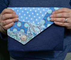 Don't throw your fabric scraps away. Learn how to make a fabric scraps clutch bag, step by step tutorial. Fabric Scraps Clutch Tutorial