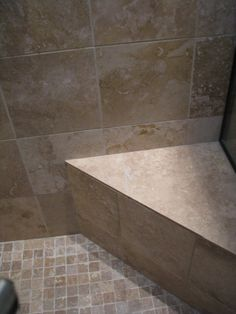 travertine with small tiles on floor