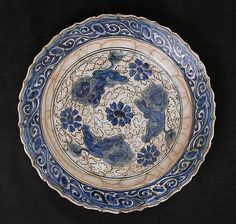 Dish with Three Lions Object Name: Dish Date: 18th century Geography: Iran Culture: Islamic Medium: Stonepaste; polychrome painted under tra...