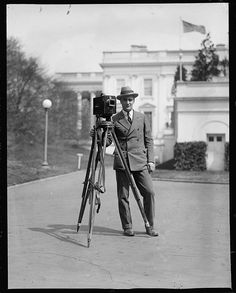 Old School Photos of People Posing With Old School Cameras