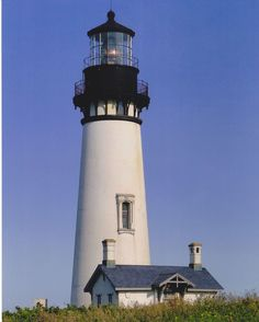 The 1873 Yaquina Head Lighthouse in Newport, Oregon stands tall with its magnificent 1st Order Fresnel lens. It is estimated that over 400,000 people a year visit the 83-foot tall lighthouse