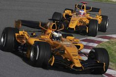 F1 - Mclaren experimenting with two different chassis prior to the 2006 Grand Prix season. Love the traditional Mclaren orange.