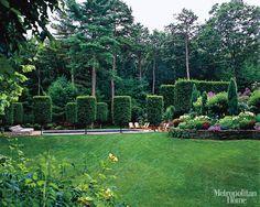 repetition of form,   formal with informal plants  A Designer's Garden - ELLE DECOR