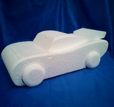 Car shaped cake dummy in the style of the disney cars movie