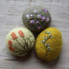 felted stones with stitching. Use as a paper weight.